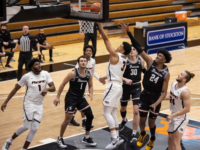 Pacific Tigers guard Pierre Crockrell II (3) makes a layup during the first half of a WCC men's basketball game Jan. 14 at Spanos Center in Stockton.