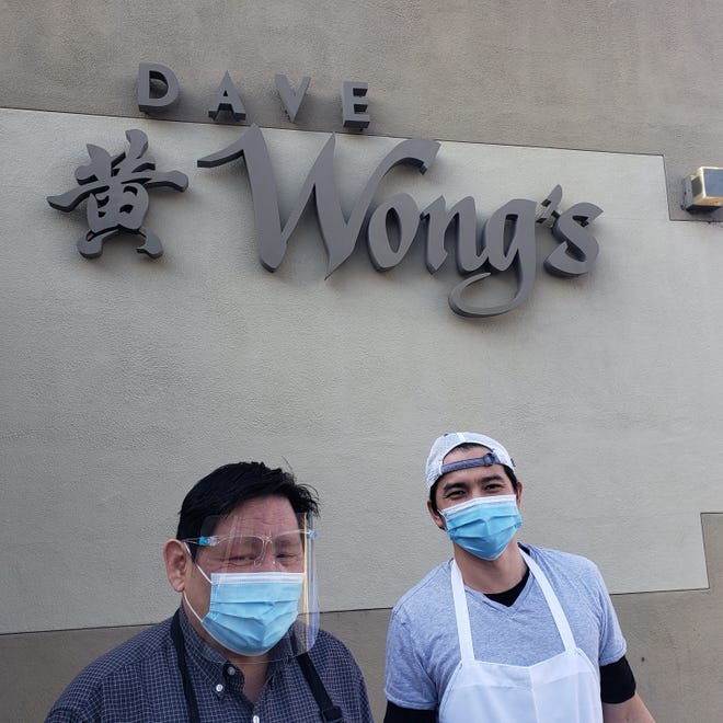 Kevin Wong, left, and Brendon Lee stand outside Dave Wong's restaurant in Stockton. Wong, the assistant general manager, is the son of former owner David Wong, who sold the restaurant to Lee and a group of other employees.