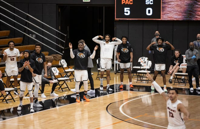 Pacific Tigers celebrate on the sideline after Pacific Tigers guard Daniss Jenkins (4) makes a layup during the first half of a  WCC men's basketball game Jan. 14 at Spanos Center in Stockton.