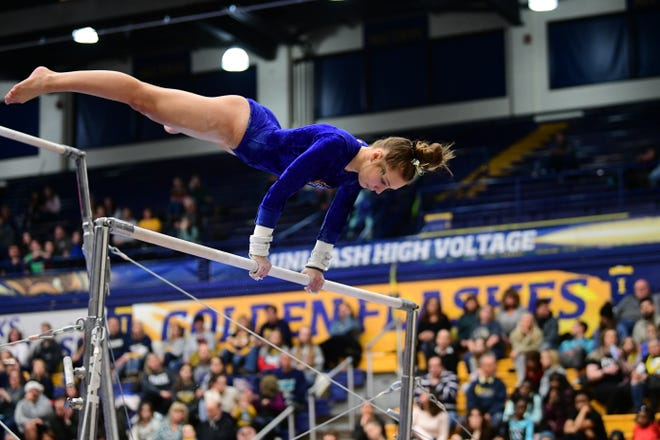Kent State sophomore Rachel DeCavitch competes on bars during a meet held last season at the M.A.C. Center.