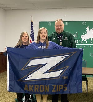 Central Catholic's Grace Crane is flanked by her parents Stacie and John on the day she signs with the University of Akron. (Photo courtesy of Central Catholic High School)