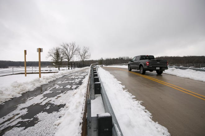 A vehicle crosses the bridge at Rock Cut State Park on Friday. The park was awarded a $900,000 state grant to address infrastructure issues.