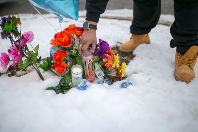 Lanetka Ingram, the mother of slain 15-year-old Jazznique Fort, cleans up Jazznique's roadside memorial at Lee and School streets on Friday, Jan. 15, 2021, in Rockford. Jazznique Fort was killed Jan. 2, 2015, and the case remains unsolved. Ingram hopes that someone who knows anything about her daughter's killing will come forward with information.