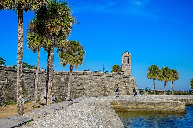 People walk around the grounds of the Castillo de San Marcos National Monument in St. Augustine on Thursday, Jan. 14, 2021.