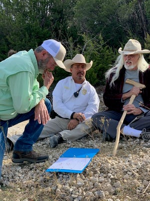 """Director Bill Foster discusses the script with Mike Alvarado III and Corbett Hall on the set of """"I've Got Your 6."""""""
