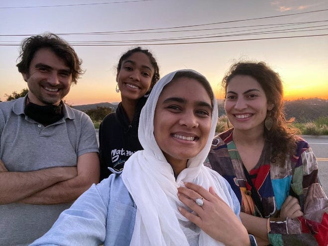The four fellows of the Abrahamic House, Jonathan Simcosky, from left, Maya Mansour, Ala' Khan and Hadar Cohen, pose for a selfie while watching a sunset in celebration of the start of Ramadan.