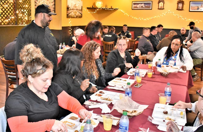 More than 30 first responders enjoyed a free luncheon Jan. 12 at the Himalayan Curry Restaurant in Richmond Hill.