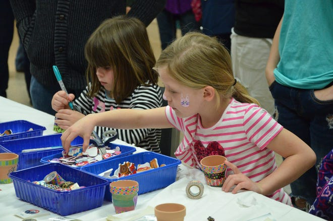 Children decorate pots during the 2019 Arts Trek event. The Mabee-Gerrer Museum of Art recently announced the annual event will be canceled in 2021 due to COVID-19.