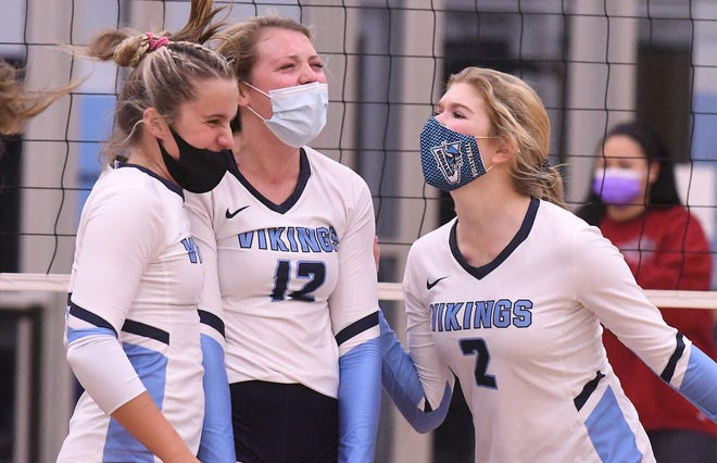 Hoggard's Martin-Maine Wrangell (from left), Gracie Sistrunk and Lena Rose Cosgrove celebrate as Hoggard swept South Central in the second round of the playoffs Thursday night. The Vikings move into the third round at Pinecrest on Saturday. [KEN BLEVINS/STARNEWS]