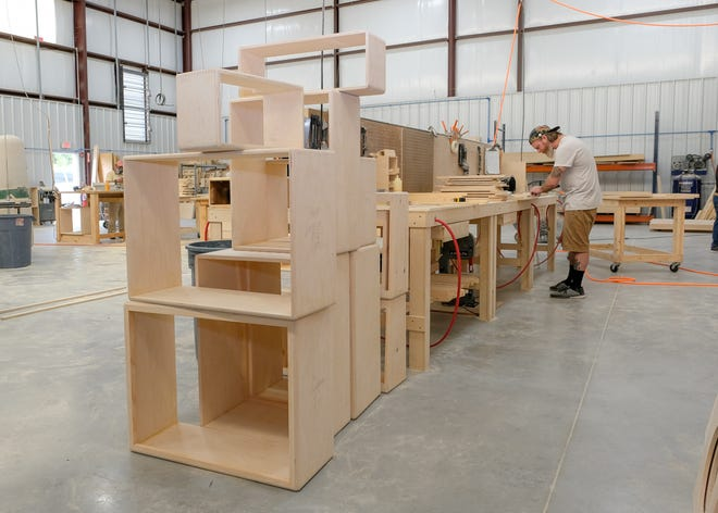 Billy Zachary constructs an amplifier cabinet at Mojotone in Burgaw.  August 13, 2018.