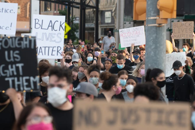 Black Lives Matter supporters fill a street in downtown Topeka on June 1, 2020.