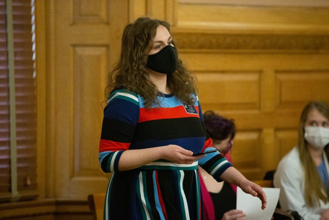 Rachel Sweet, regional director of public policy and organizing at Planned Parenthood Great Plains, stands to talk as an opponent to the Kansas constitutional amendment over abortion during a Federal and State Affairs committee hearing Friday at the Statehouse.