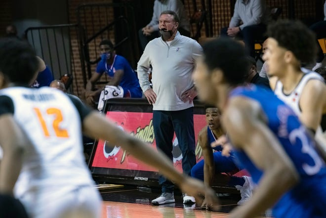 Kansas basketball coach Bill Self shouts instruction during Tuesday night's game against Oklahoma State in Stillwater, Okla. The No. 6-ranked Jayhawks lost 75-70.