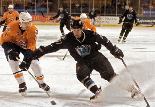 Worcester Sharks forward Mike Iggulden, right, skates toward the Bridgeport Sound Tigers goal during the 2007-08 season.