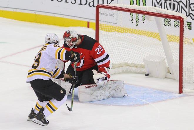 The Bruins' Brad Marchand (63) scores the shootout winner past Devils goaltender Mackenzie Blackwood Thursday night in Newark, New Jersey.