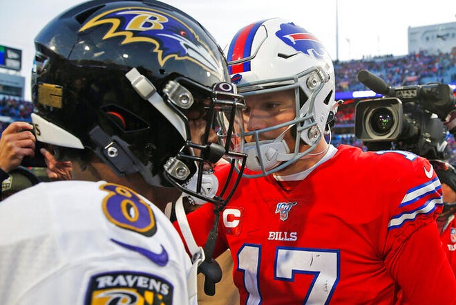 Bills quarterback Josh Allen, right, talks with Ravens quarterback Lamar Jackson after a game in 2019.