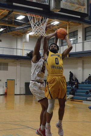 Julian Williams (0), a transfer from Village Christian Academy, anchors a talented Northwood Temple frontcourt and is averaging a team-best 16.5 points and 8.1 rebounds per game in his first season with the Eagles.