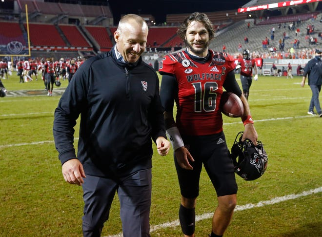 N.C. State head coach Dave Doeren laughs with quarterback Bailey Hockman (16) after N.C. State's 38-22 victory over Florida State at Carter-Finley Stadium in Raleigh, N.C., Saturday, Nov. 14, 2020.