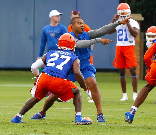 Christian Robinson, the Florida Gators linebackers coach, works with players while the football team opens fall practice at the Sanders Practice Fields on the UF campus in Gainesville, Fla., July 26, 2019.     [Brad McClenny/The Gainesville Sun]