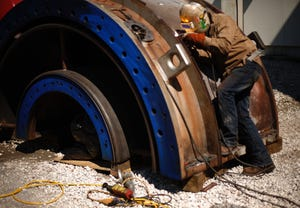 A welder works on a gas turbine at Gainesville Regional Utilities' Kelly Power Station in 2014.