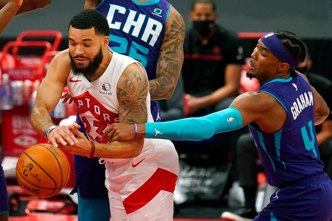 Toronto Raptors guard Fred VanVleet (23) gets fouled by Charlotte Hornets guard Devonte' Graham (4) during the first half of an NBA basketball game Thursday, Jan. 14, 2021, in Tampa, Fla. (AP Photo/Chris O'Meara)