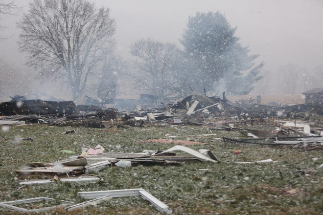 Smoke was still rising late Friday morning from the site of a house on Fillman Bottom Road that was leveled in a Thursday evening explosion.