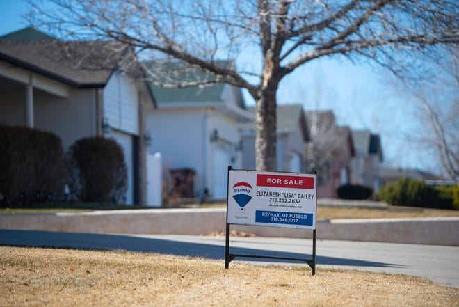 A 'for sale' sign sits on the front lawn of a home on Pueblo's south side.