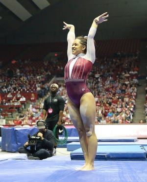 The University of Alabama's Makarri Doggette, shown in a 2020 meet against Georgia, was named the SEC Specialist of the Week in gymnastics for her performance in Alabama's 2021 season opener.