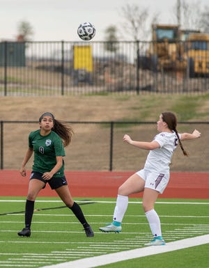 Waxahachie's Angel Garfias (9) defends during a match last season. The Lady Indians are 5-0 on the 2021 season with shutouts in all five games.
