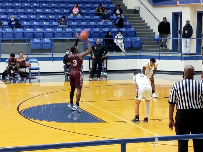 Ennis' Dee Johnson shoots a free throw during Tuesday night's District 14-5A boys' basketball game at Corsicana.