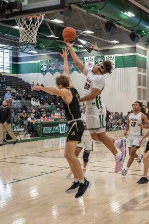 Waxahachie senior CJ Noland (22) makes a move to the basket during a home game last month. Noland achieved the career mark of 1,500 points on Tuesday as the Class 6A No. 1-ranked Runnin' Indians beat No. 21 Mansfield High at Mike Turner Gymnasium, 89-66.