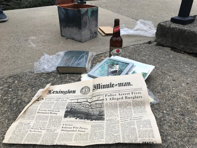 The items contained in the time capsule found at Highrock Church in Lexington laid out on the ground nearby.