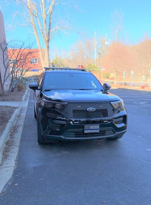 """Weaverville Police Department vehicles, like this one, have a """"Blue Lives Matter"""" license plate on the front."""