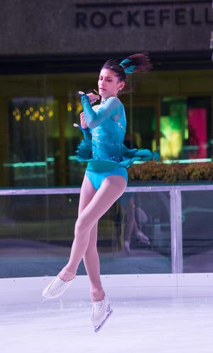 Mount Saint Mary Academy junior Cassandra Cavuoto performs at the Figure Skating Show at Rockefeller Center.