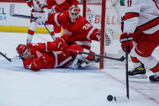 Detroit Red Wings quarterback Troy Stecher (70) and goalkeeper Thomas Gries (29) defended the goal against Carolina Hurricane Center Jordan Stal (11) during the second period. The opening of the season at Little Caesars Arena in Detroit on Thursday January 14, 2021.