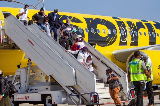 Passengers get off a Spirit Airlines plane after landing at the Toussaint Louverture International Airport in Port-au-Prince, Haiti, July 1, 2020. Commercial flights resumed at the Port-au-Prince international airport, almost three and a half months after its closure due to the arrival of COVID-19 in the country. The first flight arrived in Port-au-Prince from Fort Lauderdale, Florida, the state where most of the Haitian immigrants living in the United States live. (Jean Marc Herve Abelard/EFE/Zuma Press/TNS)