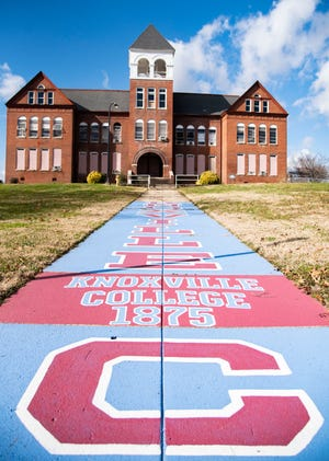 A painted sign walk in front McKee Hall at Knoxville College in Knoxville, Tenn., on Friday, Jan. 15, 2021.