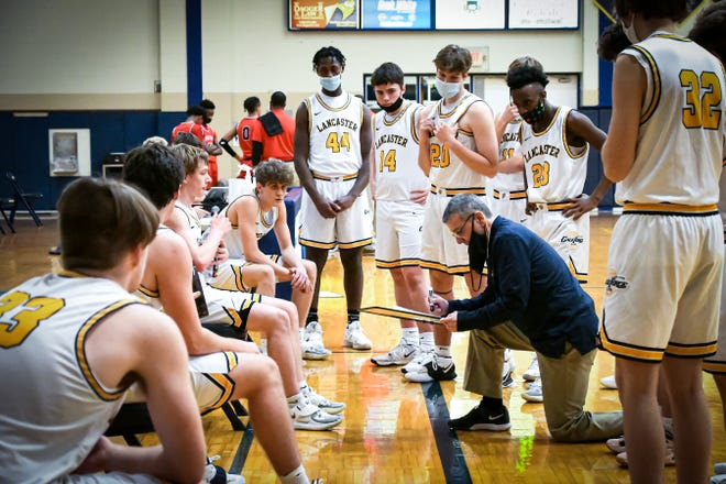 Lancaster boys basketball coach Kent Riggs gives instructions to his players during a timeout in a game against Groveport. The Golden Gales are 7-3 on the season, but are now in quarantine for 14 days because a player tested positive for COVID-19.