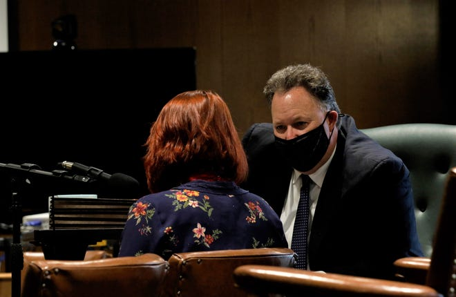 Attorney Jason Price, right, speaks with his client, Colleen Downard, to explain the plea deal she was about to sign in Fairfield County Common Pleas Court Thursday, Jan. 14. Downard pleaded guilty to four felony counts of aggravated drug trafficking. Sentencing is set to happen in May.
