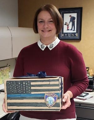 Anna Ruzinski received a personalized box of local items to recognize her community work. Her last day as Menomonee Falls police chief was Jan. 9. The Boxes4BADGES program plans to recognize all sworn-in law enforcement for their work in the community.