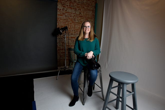 Liz Argyle, owner of Argyle Photography, in her studio on South 3rd Street in Newark. Argyle started out homing her photo skills on friends and now captures memories for families throughout Licking County.