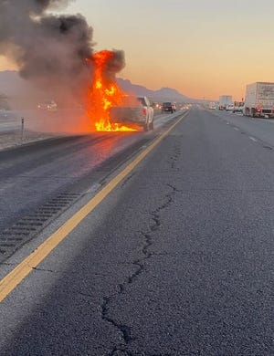 Three off-duty Las Cruces Police Department officers assisted in extinguishing a vehicle fire on I-10 Wednesday.
