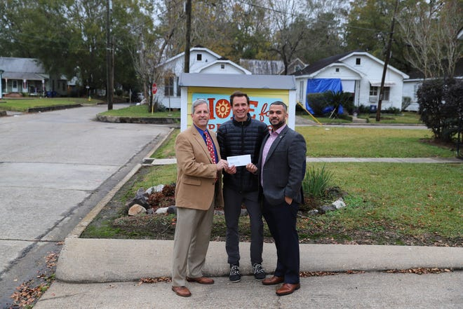 Hope For Opelousas Executive Director Loren Carriere, center, is flanked by Cody Begnaud and Dale Hewitt of Opelousas nursing homes Heritage Manor and Senior Village. Begnaud and Hewitt recently presented Carriere and Hope For Opelousas with a $10,000 donation.