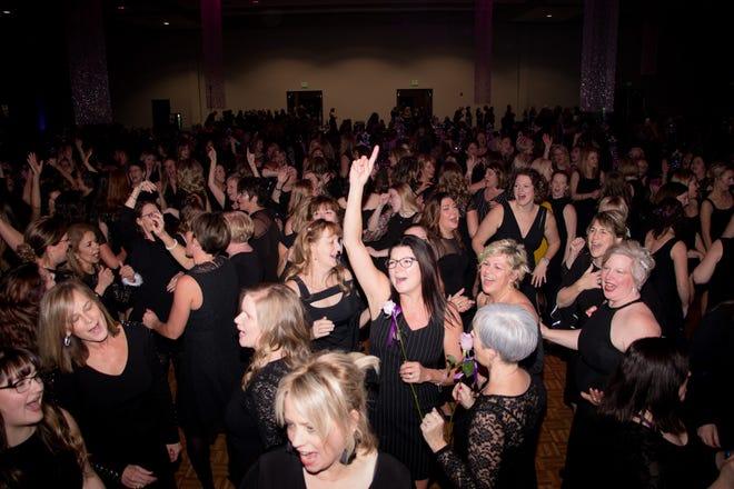 Women dance at a past Blue Water Little Black Dress event at the Blue Water Convention Center.