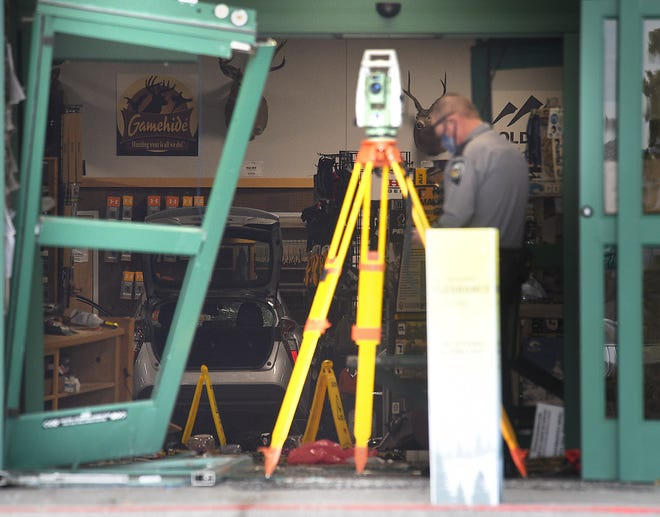 Police investigate to site of a car accident at the Sportsman's Warehouse in Carson City on Jan. 15, 2021. A car drove into the east side entrance to the store and injured multiple people.