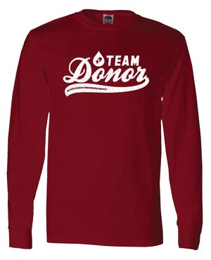"""Donors during Blood Donor Awareness Month receive a """"Team Donor"""" long-sleeved shirt."""