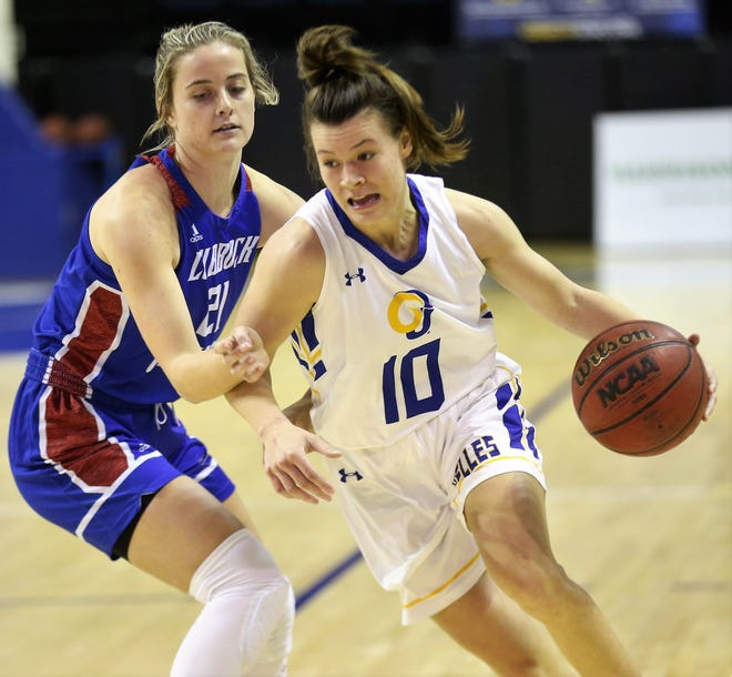 Angelo State University's Sawyer Lloyd, 10, is defended by Lubbock Christian's Allie Schulte in a Lone Star Conference basketball game at the Junell Center on Thursday, Jan. 14, 2021. LCU won, 65-55.
