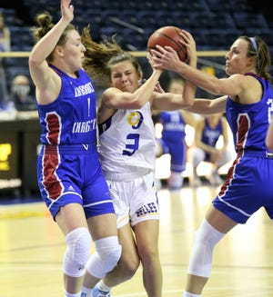 Angelo State University's Sadie Misner, 3, gets ready to put up a shot between Lubbock Christian defenders in a Lone Star Conference basketball game at the Junell Center on Thursday, Jan. 14, 2021.