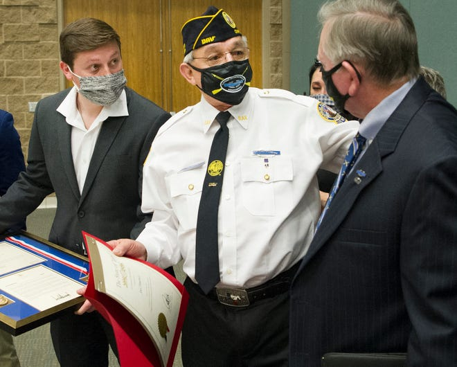 Disabled American Veteran Chapter 41 Commander, Joel Jimenez, center, was congratulated Friday morning after receiving the Presidential Volunteer Service Award during a ceremony held at the MPEC.