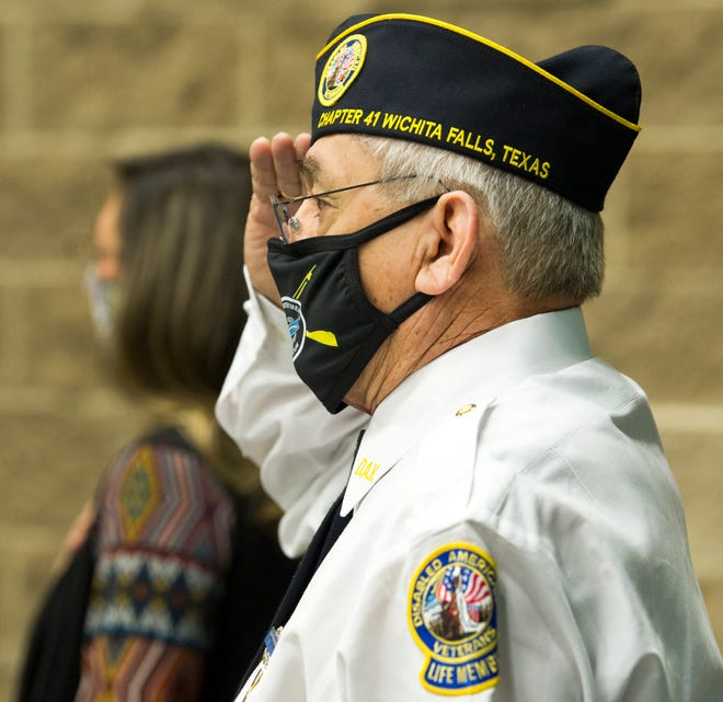 In this file photo, Disabled American Veteran Chapter 41 Commander, Joel Jimenez salutes the American Flag during an award ceremony. There will be a Pause for the Pledge event open to the public Monday, June 14 at 6 p.m. at Memorial Stadium.